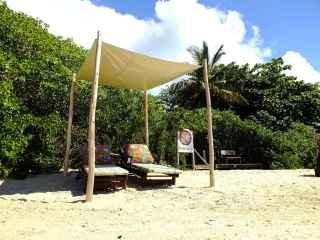 1540403127-praia-pousada-mandala-em-cumuruxatiba-cadeiras.jpg