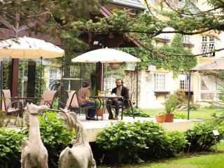 1605467692-cafe-da-tarde-jardim-hotel-pousada-le-chateau-gramado-001.jpg