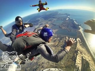 1622756112-paraquedismo-na-praia-do-rosa.jpg